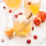 Cider in a mug with star decorations and cranberries
