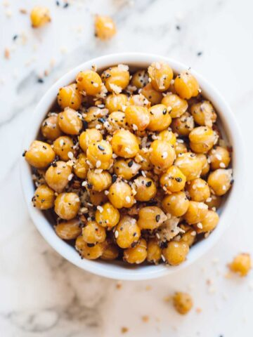Over head shot of a white bowl full of garbanzo beans seasoned with Everything but the Bagel Seasoning and panko crumbs.
