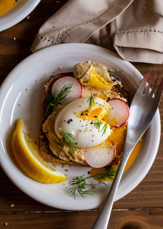Everything but the bagel seasoning on top of hummus toast and poached egg