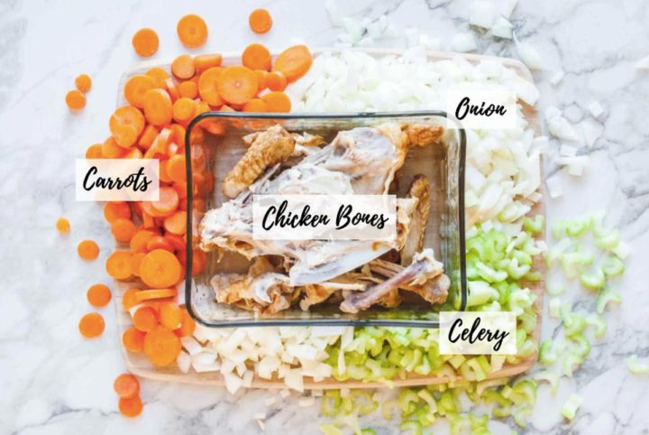 Overhead image of the four recipe ingredients scattered around on top of a wood cutting board.
